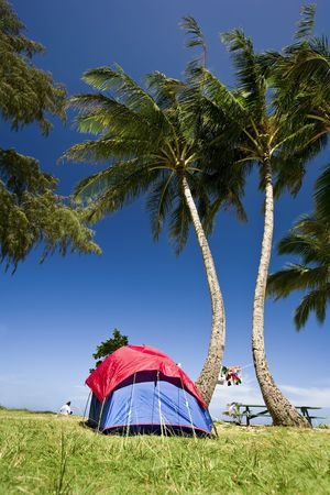 Brigh Blue and red tent with clothes hanging to  dry in Kauai, Hawaii Stock Photo