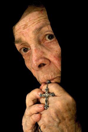 eligion: Old Women Deep in Prayer wearing a black Veil