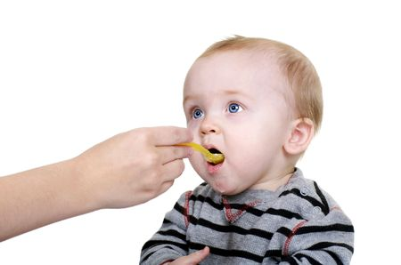 Cute Baby Eating at Mealtime Stock Photo