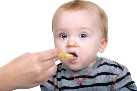 baby rice: Sweet Baby Boy Eating his Rice Cereal Stock Photo