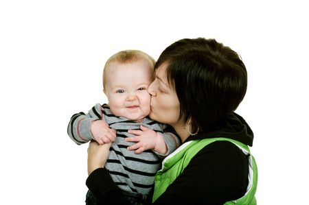 happy mother giving her baby a kiss Stock Photo - 3992843