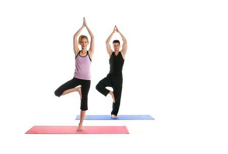 Attractive Couple Doing Yoga