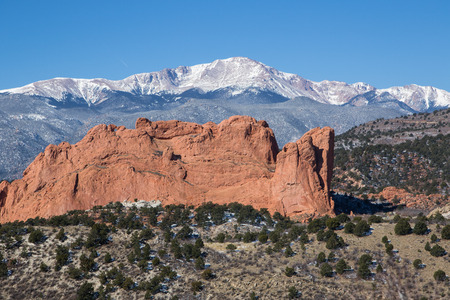 red mountain open space: Kissing Camels rocks in Garden of the Gods with Pikes Peak in the background on a sunny day