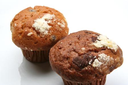 Chocolate and vanilla muffins on white background