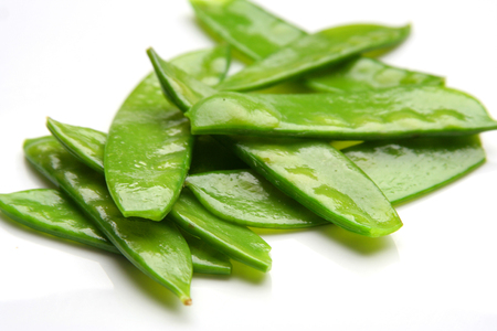 Group of fresh snow peas vegetables over a white background