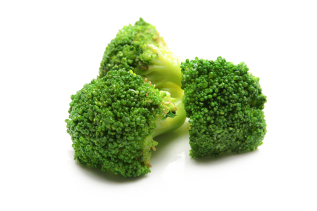Group of broccoli vegetables isolated over a white background