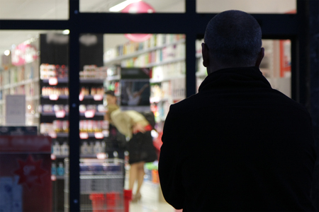 man looking in the evening inside the store