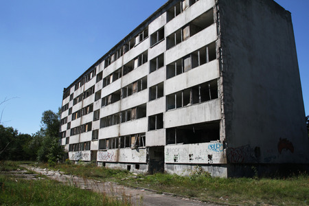 multifamily: Abandoned, deprived of windows and waiting for the demolition of a block of flats Stock Photo