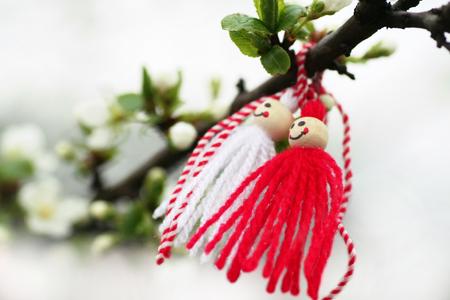 Folk, Bulgarian, white - red Martenica (Baba Marta) on a blooming apple tree, Margeritta.