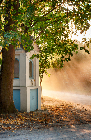 rural, old chapel standing at crossroads of dirt roads with nice shaded light