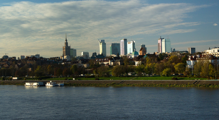 Panorama of Warsaw with the PKN, skyscrapers with boats on the Vistula River