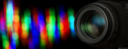 Photo lens and black background with individual light blur Stock Photo