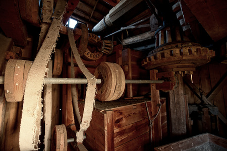 The original, wooden mechanism of an old windmill, grain mill