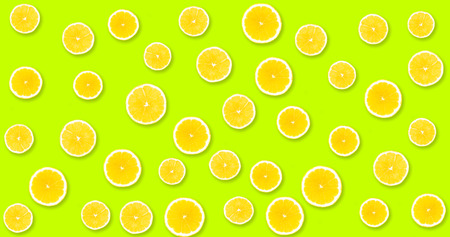 Background with yellow lemons from under which you can see in lime color, uniform background