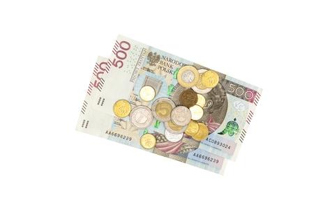 Polish banknotes PLN 500 and small coins