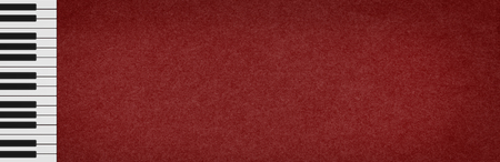 White and black keys on a piano keyboard on a dark, elegant, red background with the structure of an old paper