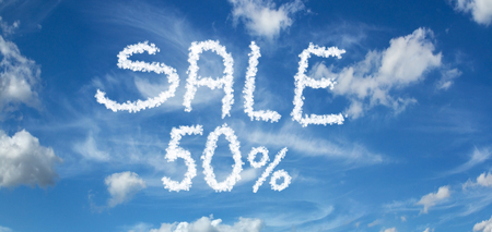 SALE 50% inscription painted with clouds on a blue background with white clouds