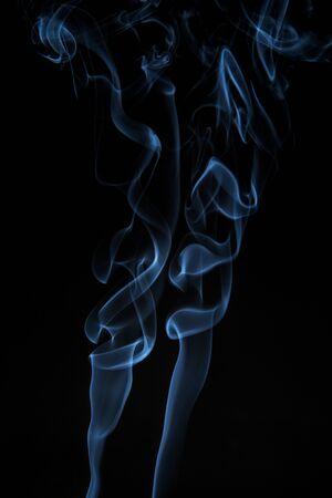 Blue, twisted smoke on a black background 写真素材