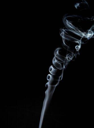 Gray, twisted smoke on a black background 写真素材