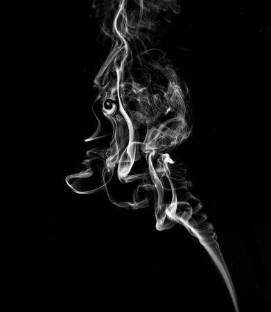 White, twisted smoke on a black background