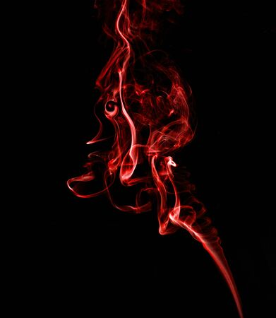 Red, twisted smoke on a black background 写真素材