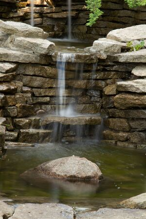 A small cascade of water, a waterfall in the garden. 写真素材 - 126663527