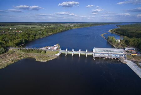 The dam and hydroelectric power station on Zegrzyński Lake from the birds eye view with a nice sky with clouds