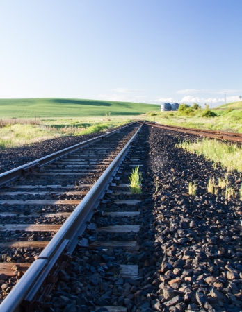 Rail road in the middle of farm land Banco de Imagens