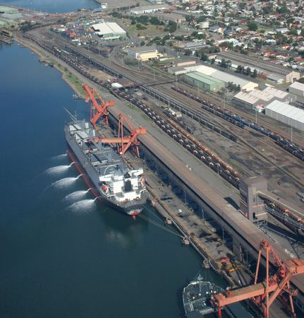 Coal being loaded into a ship at Newcastle Australia - Southern Hemisperes largest coal export port Stock Photo