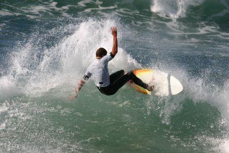 A surfer slashes a turn