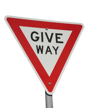 A give way sign isolated on white