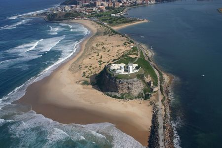 place of interest: Aerial view of Nobbys Lighthouse - Newcastle Australia. A prominent local landmark.