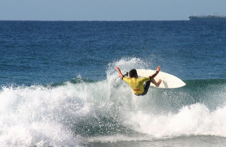 floater: A surfer pulls a floater.  Stock Photo