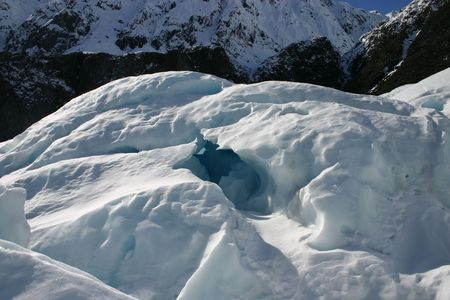fox glacier: The entrance to an ice cave. Fox glacier New Zealand.