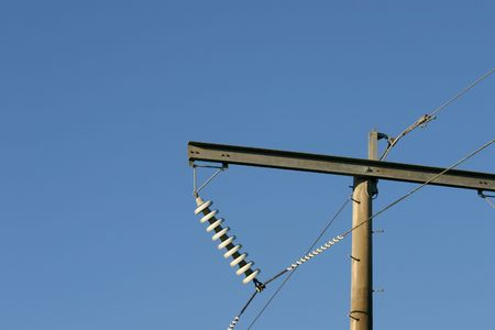 the insulator: A 132kV powerline with crossarm and disc insulator string. Stock Photo