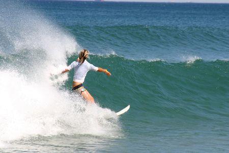 A girl bottom turns on a nice wave. Newcastle Beach Australia