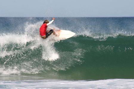 A surfer doing a floater