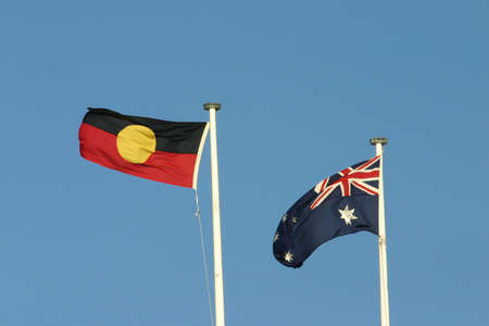 An Australian and Aboriginal Flag blowing in the wind together photo