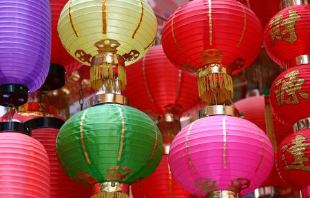 Bright coloured Chinese lanterns in a street market in Hong Kong.