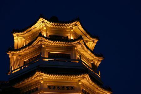 bejing: Illuminated Chinese pagoda by night, Beijing China Stock Photo