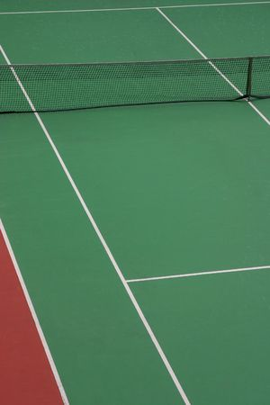 An empty green synthetic tennis court showing the sideline and net Stock Photo - 3179005
