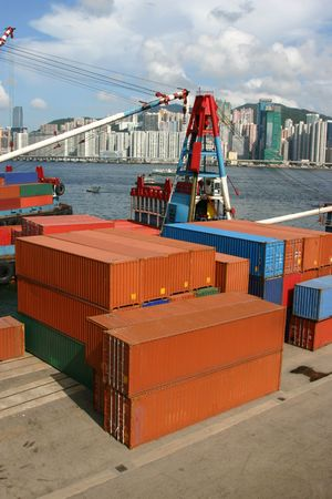 Stacks of shipping containers at a port in Hong Kong photo