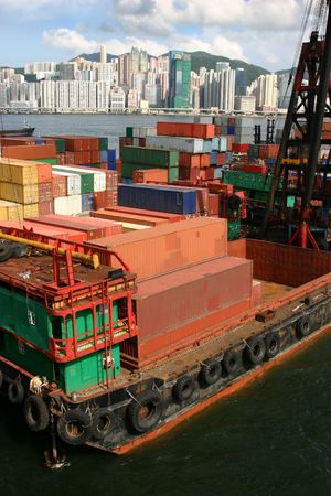 Stacks of shipping containers at a port in Hong Kong Stock Photo - 3644478