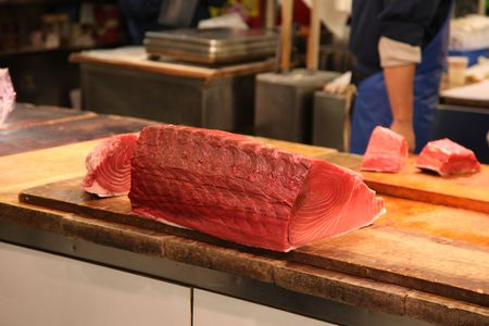 destined: Tuna being prepared for sale at Tokyos Tsukji Fish Market. Destined for the table as Sushi or Sashimi.