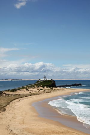 A beautiful sunny day at Nobbys Beach and Lighthouse. Newcastle Australia. Popular local attraction.