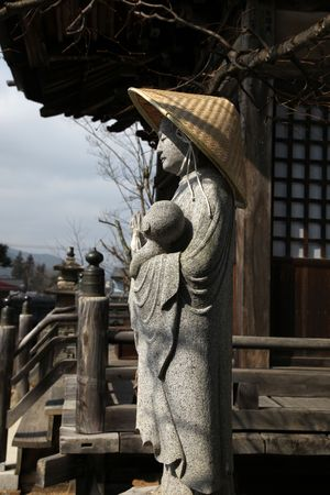 A religious statue outside a traditional Japanese Temple in Takayama Japan Stock Photo - 5998503