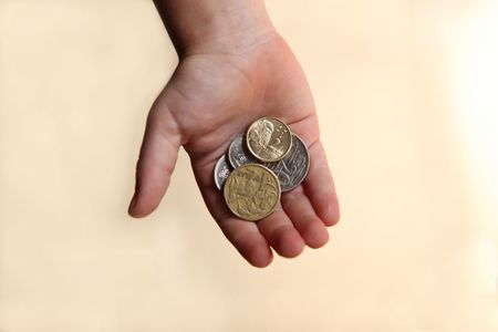 pocket money: Boy holding some Australian coins in his open hand. Representing a childs pocket money or savings