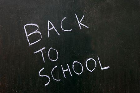 back to school written on a chalk board Stock Photo - 6231760
