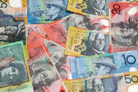 Various Australian banknotes spread randomly