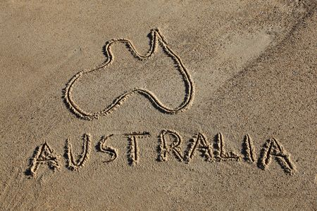 australia beach: Australia Map and word drawn in the sand at the beach. Australias beaches are one of its iconic drawcards. Stock Photo